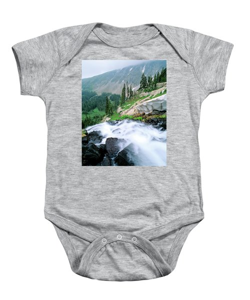A Waterfall Flows Out Of Lake Isabelle Baby Onesie