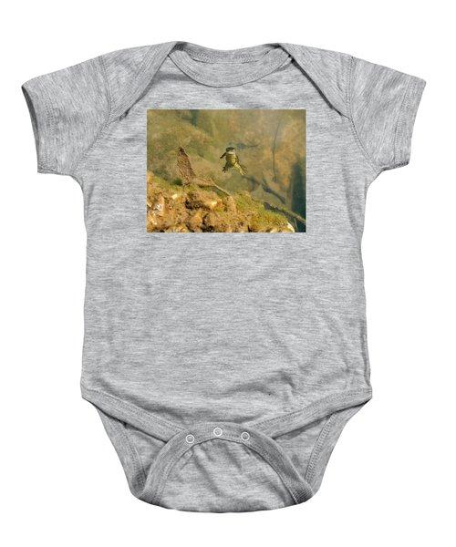 Eastern Newt In A Shallow Pool Of Water Baby Onesie by Chris Flees