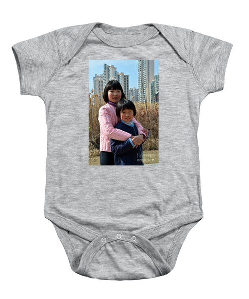 Two Chinese Teen Sisters Hug  And Embrace Shanghai China Baby Onesie
