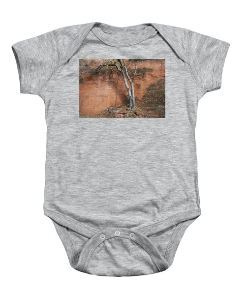 White Tree And Red Rock Face Baby Onesie