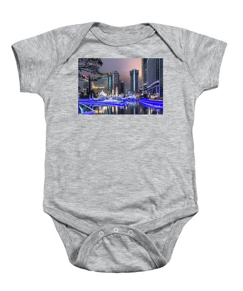 The Office Buildings Reflects In The Water Of The Klang River In Baby Onesie