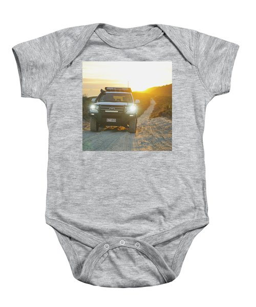 4wd Car Explores Sand Track In Early Morning Light Baby Onesie