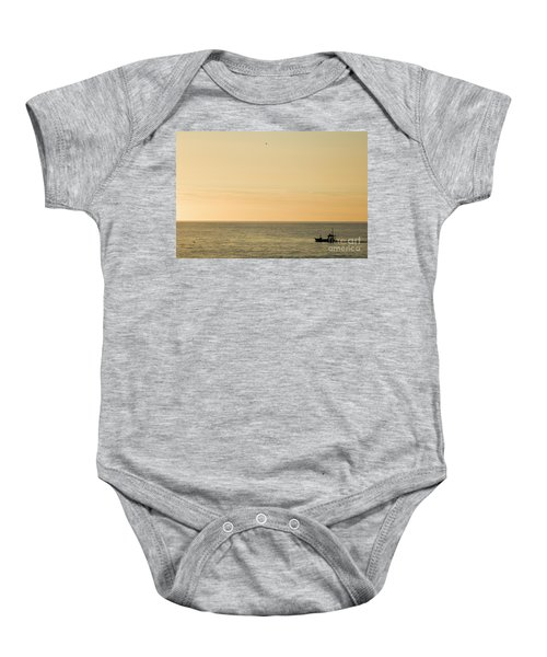 A Small Fishing Boat In Sunset Over Cardigan Bay Aberystwyth Ceredigion West Wales Baby Onesie