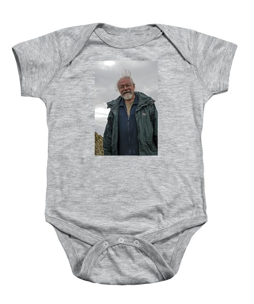 Baby Onesie featuring the photograph An Englishman In Castlerigg, Uk by Dubi Roman