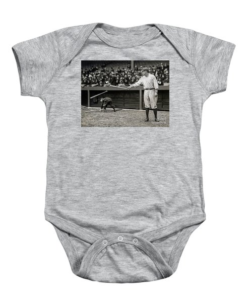 Babe Ruth At Bat Baby Onesie by Jon Neidert