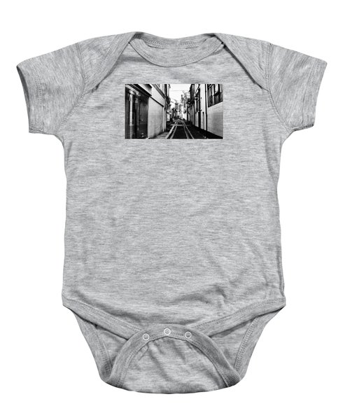 Baby Onesie featuring the photograph Backstreet by Pedro Fernandez