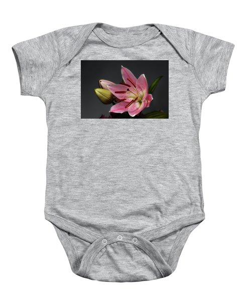 Blossoming Pink Lily Flower On Dark Background Baby Onesie
