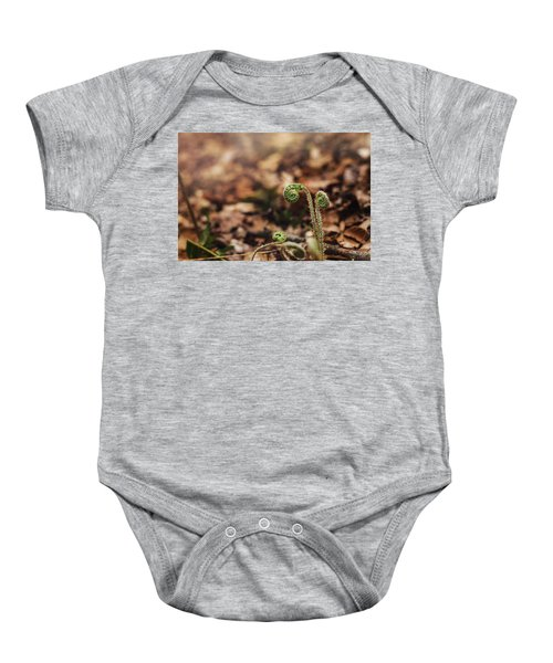 Coiled Fern Among Leaves On Forest Floor Baby Onesie