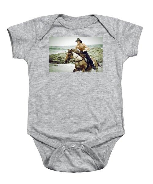 Cowboy Riding Horse On The Beach Baby Onesie