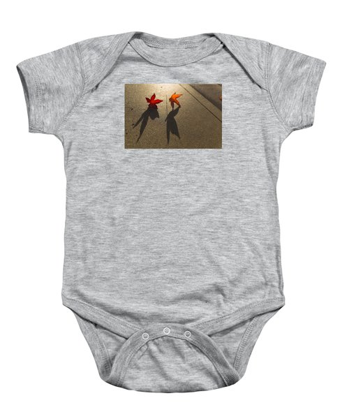 Baby Onesie featuring the photograph Dancing Leaves by Lora Lee Chapman
