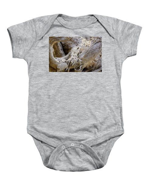 Driftwood On The Beach Baby Onesie