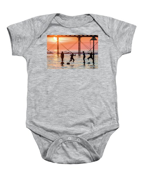 Four Girls Jumping Into The Sea At Sunset Baby Onesie