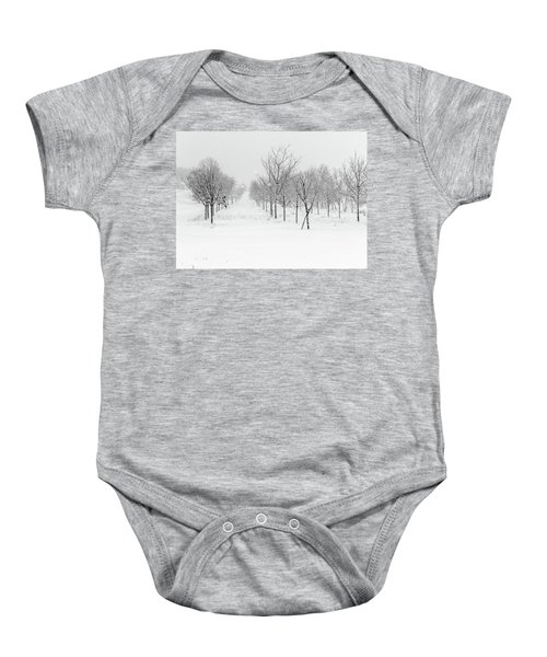 Grove Of Trees In A Snow Storm Baby Onesie