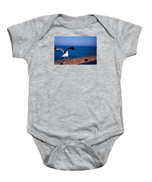 Baby Onesie featuring the photograph Gull Dance by Lora Lee Chapman