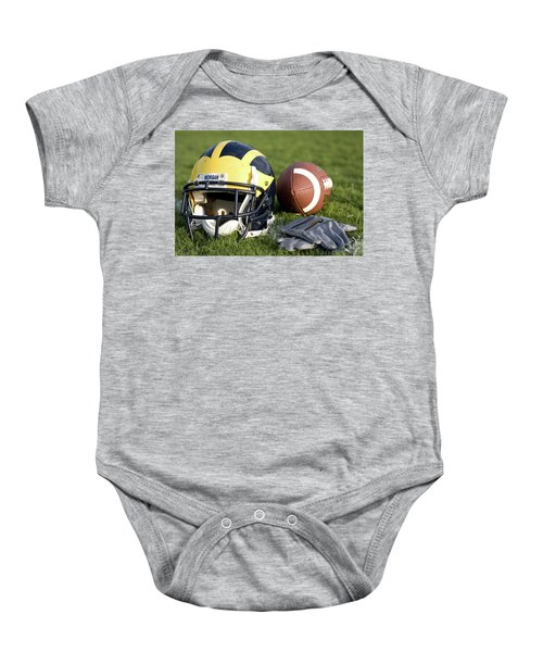 Helmet On The Field With Football And Gloves Baby Onesie