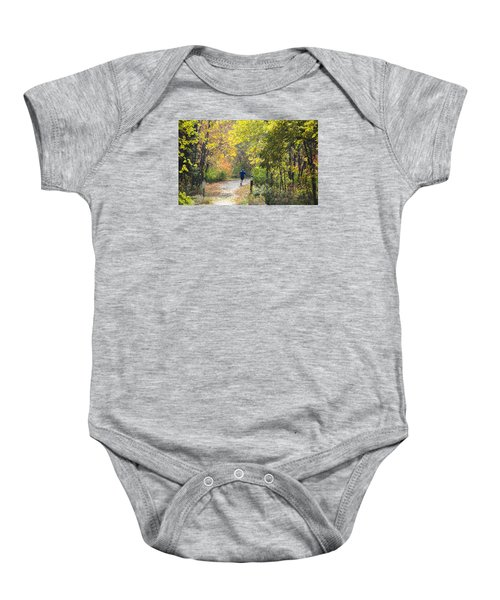 Jogger On Nature Trail In Autumn Baby Onesie