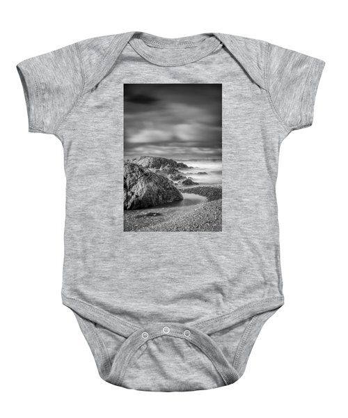 Long Exposure Of A Shingle Beach And Rocks Baby Onesie