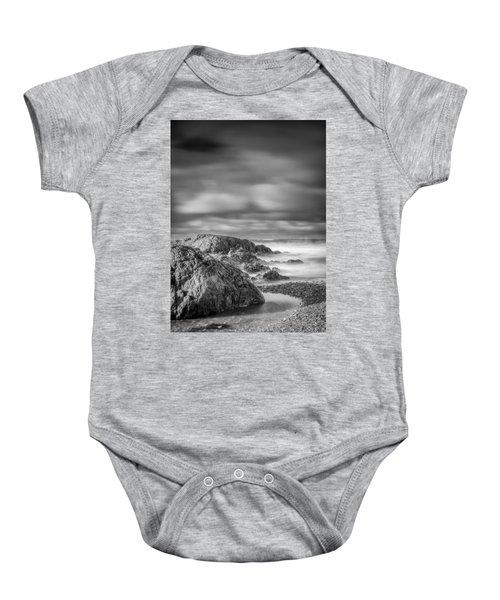 Long Exposure Of A Shingle Beach And Rocks Baby Onesie