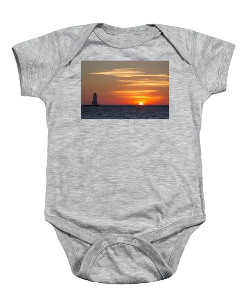 Baby Onesie featuring the photograph Ludington North Breakwater Light At Sunset by Adam Romanowicz