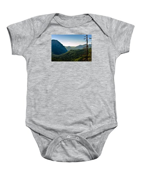 Baby Onesie featuring the photograph Misty Mountains by Anthony Baatz
