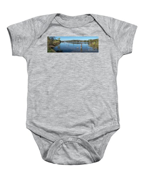Panoramic View Of Large Lake With Grass On The Shore Baby Onesie