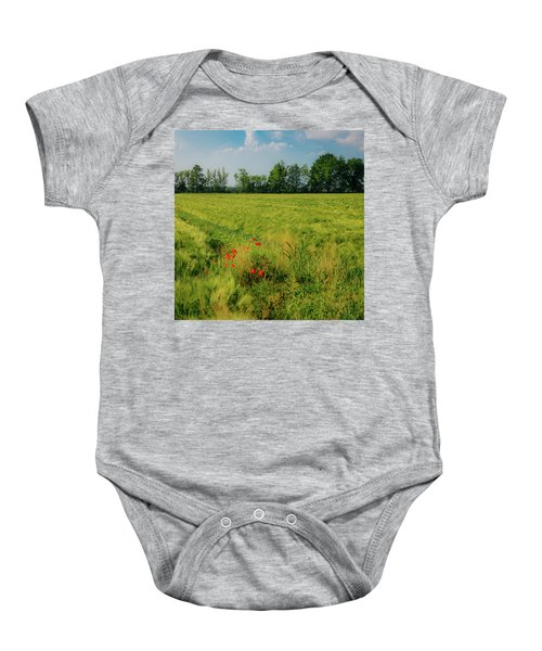 Red Poppies On A Green Wheat Field Baby Onesie