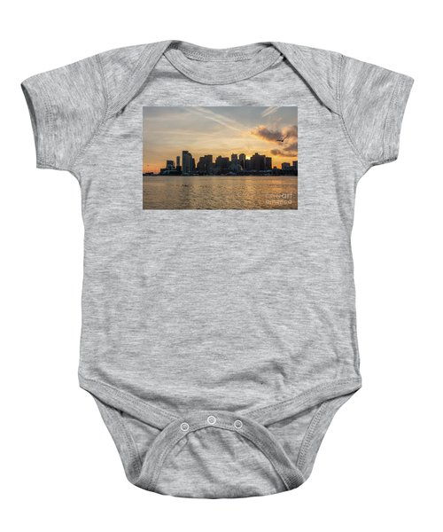 Seagull Flying At Sunset With The Skyline Of Boston On The Backg Baby Onesie