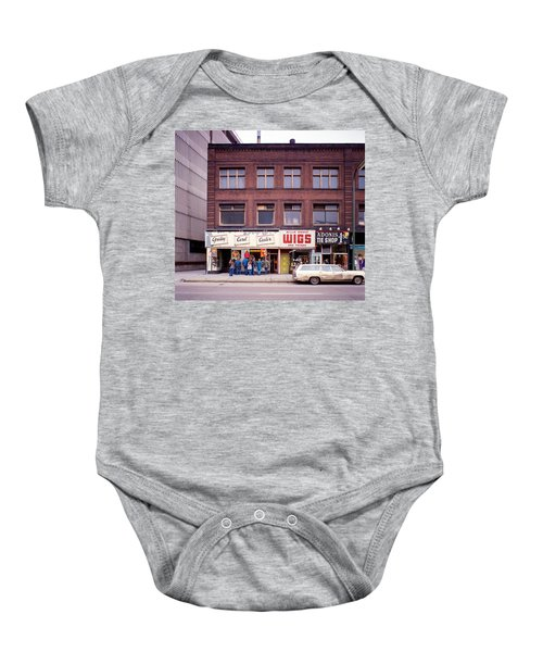 Something's Going On At The Greeting Card Center. Baby Onesie