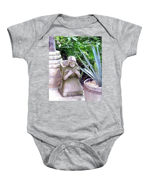 Baby Onesie featuring the photograph Stone Girl With Basket And Plants by Francesca Mackenney