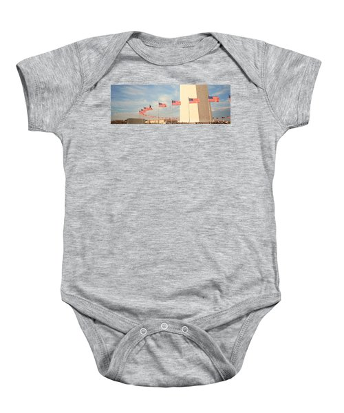 United States Flags At The Base Baby Onesie by Panoramic Images