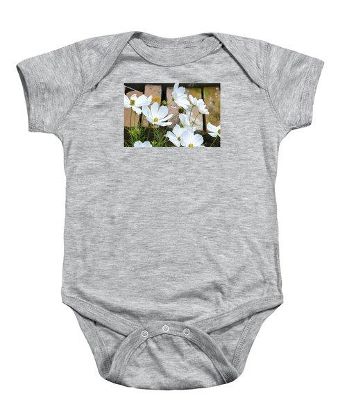 White Flowers Against Bricks Baby Onesie