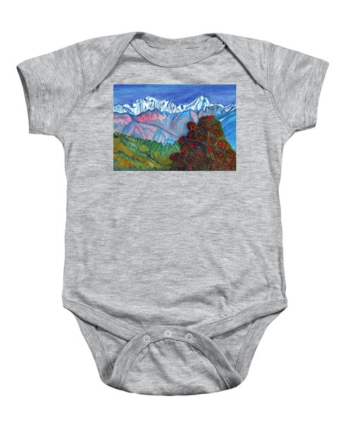Blooming Tree On A Background Of Snowy Mountains Baby Onesie