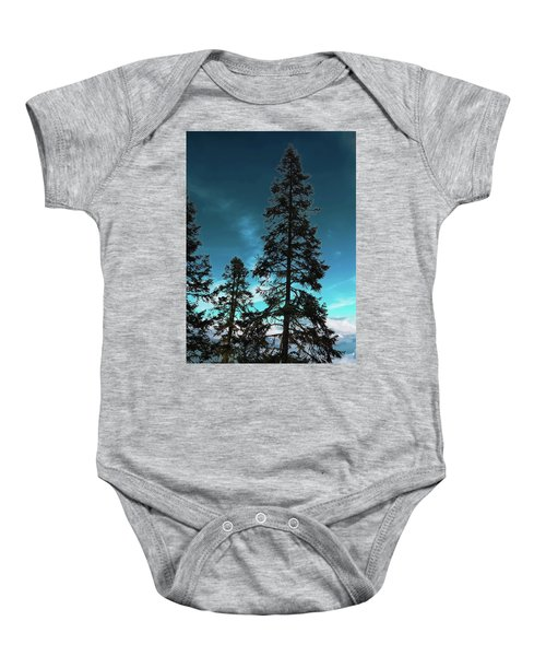 Silhouette Of Tall Conifers In Autumn Baby Onesie