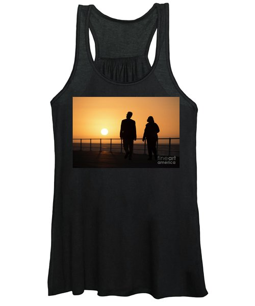 A Couple In Silhouette Walking Into The Sunset Women's Tank Top