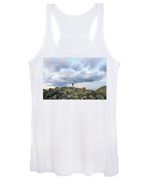 A Backpacker Stands Triumphantly Atop Women's Tank Top