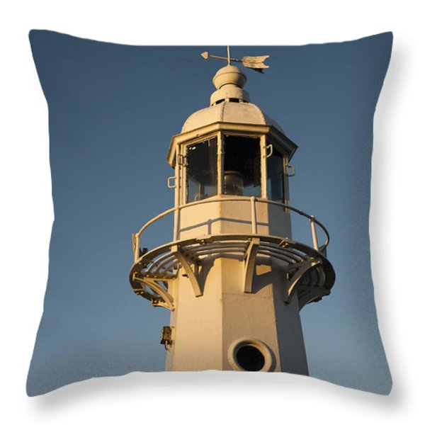 Mevagissey Lighthouse In The Evening Throw Pillow by Anne Gilbert