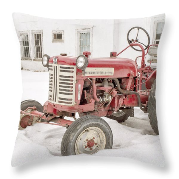 Old Red Tractor In The Snow Throw Pillow by Edward Fielding