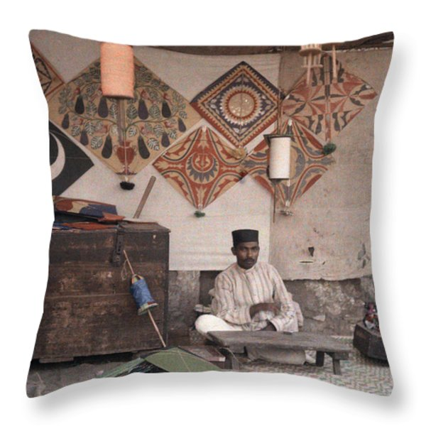 A Kite Merchant Sits In His Store Throw Pillow by Gervais Courtellemont