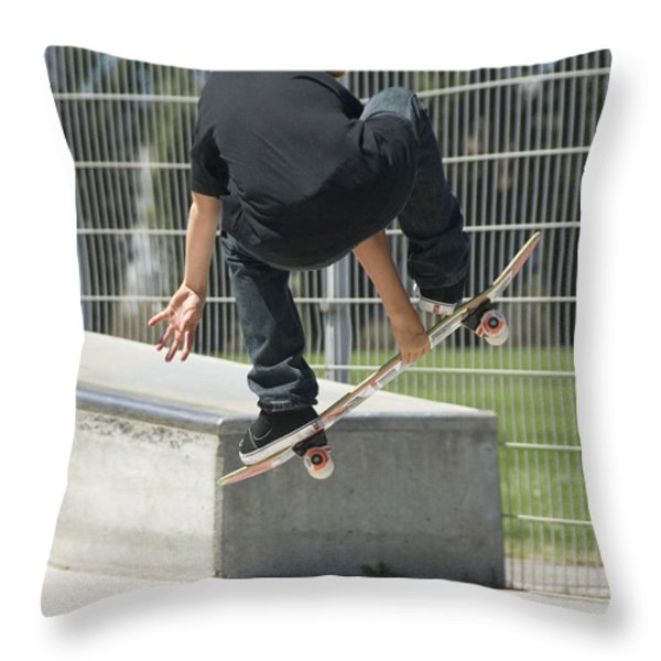 A Young Boy Flying Through The Air Throw Pillow by Stephen Sharnoff