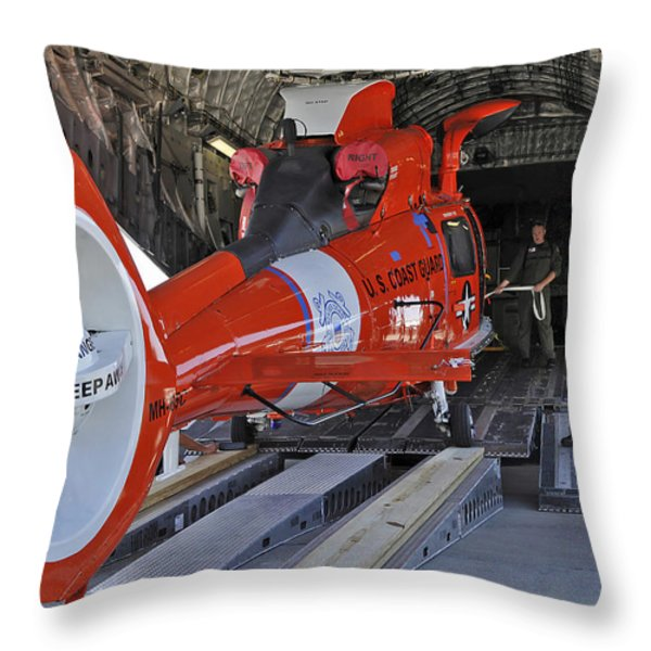 An Aircrew Loads A Coast Guard Hh-65 Throw Pillow by Stocktrek Images