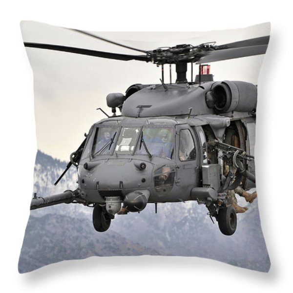 An Hh-60 Pave Hawk Helicopter In Flight Throw Pillow by Stocktrek Images