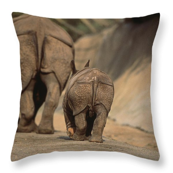 An Indian Rhinoceros And Her Baby Throw Pillow by Michael Nichols
