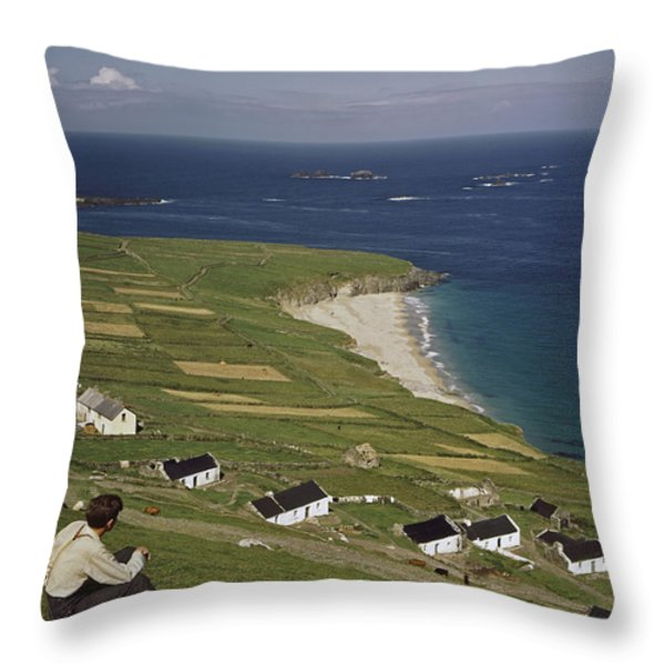 An Irishman Overlooks Cottages That Throw Pillow by Howell Walker