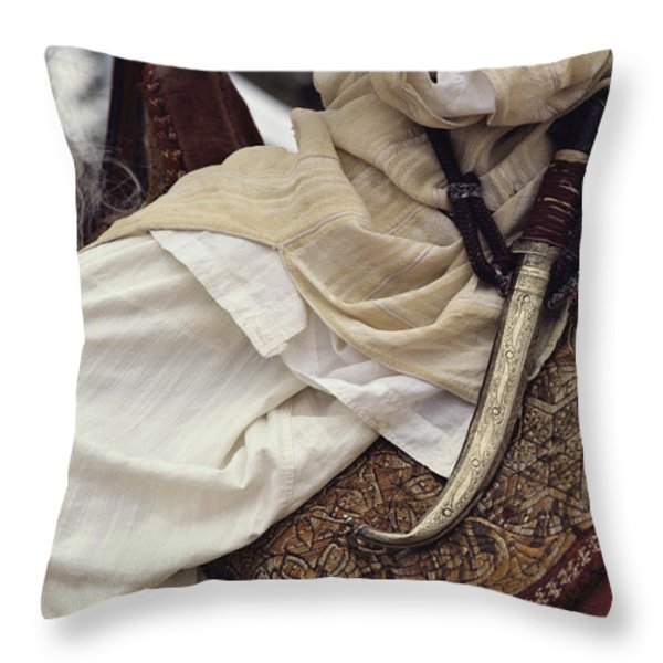 Close View Of A Scimitar On A Horseback Throw Pillow by Steve Winter