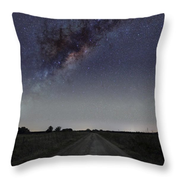 The Milky Way Galaxy Over A Rural Road Throw Pillow by Luis Argerich