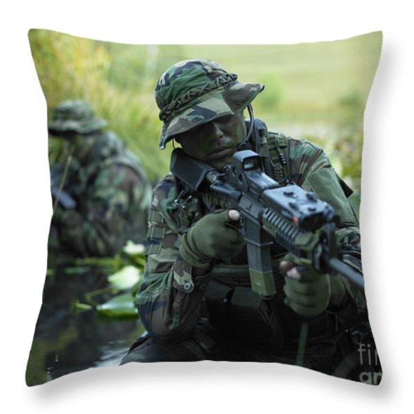 U.s. Navy Seals Cross Through A Stream Throw Pillow by Tom Weber