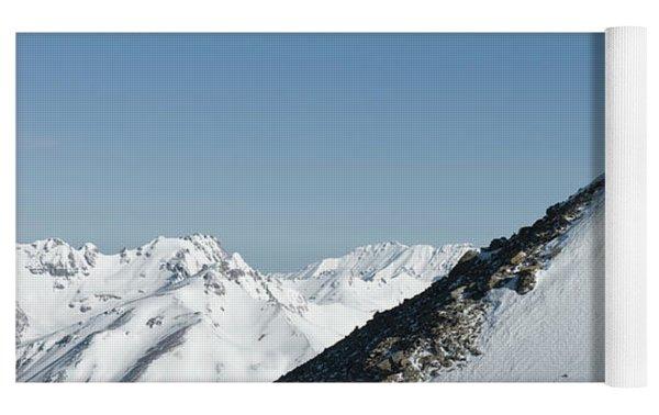 A Man Stands Atop A High Ridge Line Yoga Mat by Kennan Harvey