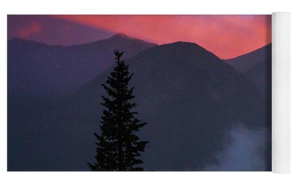 Sunset Storms Over The Rockies Yoga Mat by John De Bord