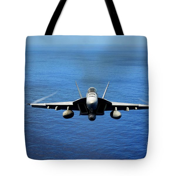 Tote Bag featuring the photograph  A Fa-18 Hornet Demonstrates Air Power. by Paul Fearn