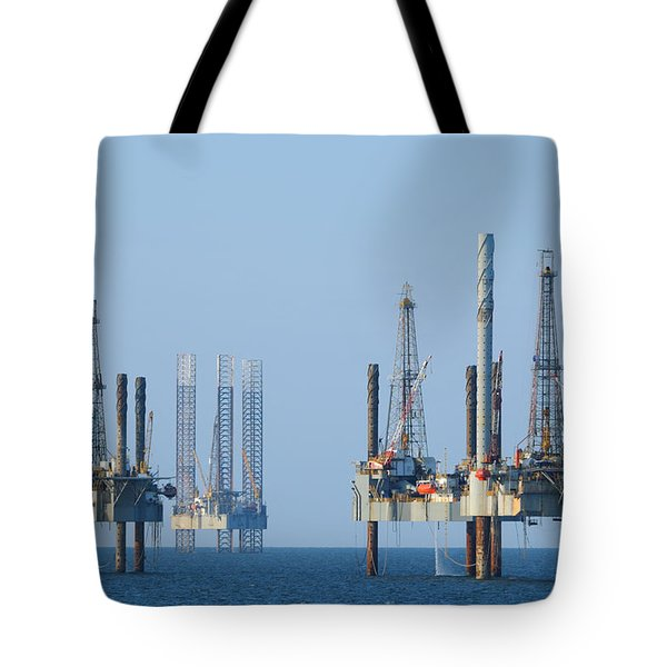 Tote Bag featuring the photograph  Four Jack Up Platforms by Bradford Martin
